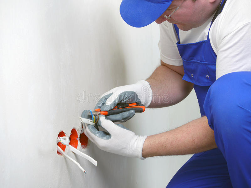 Wall socket installation stock photos