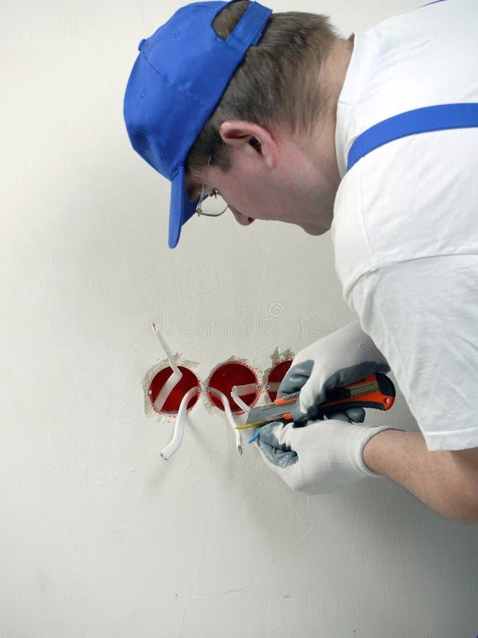 Wall socket installation royalty free stock image