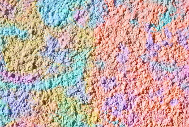 Mixed media artwork, abstract colorful artistic painted layer in pink, blue, yellow color palette on grunge decorative plaster. Texture photography background royalty free stock photos