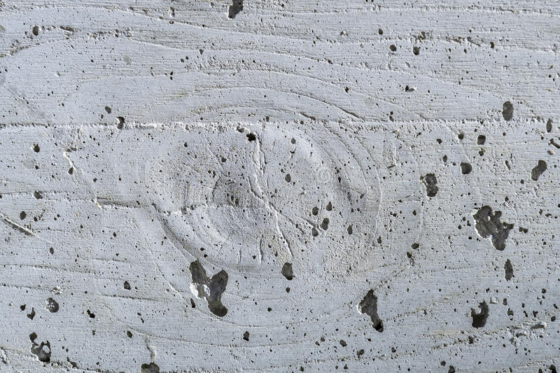 Wall stamp in concrete construction, gnarl and wood like patter. N after shuttering was removed stock photos