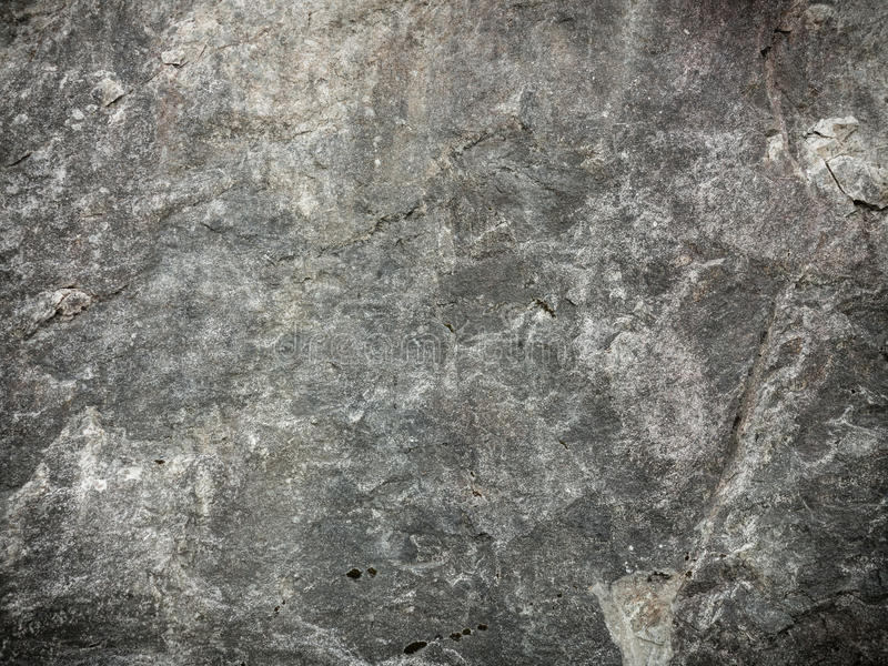 Wall stone background or texture solid nature rock. Brown grunge wall stone background or texture solid nature rock royalty free stock photo