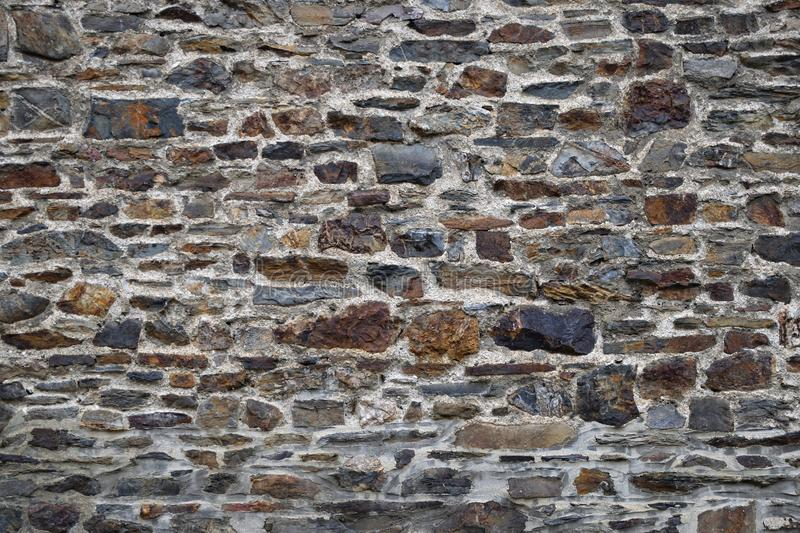 Wall stone rock texture rustic strong aged outdoor. Background stock photos