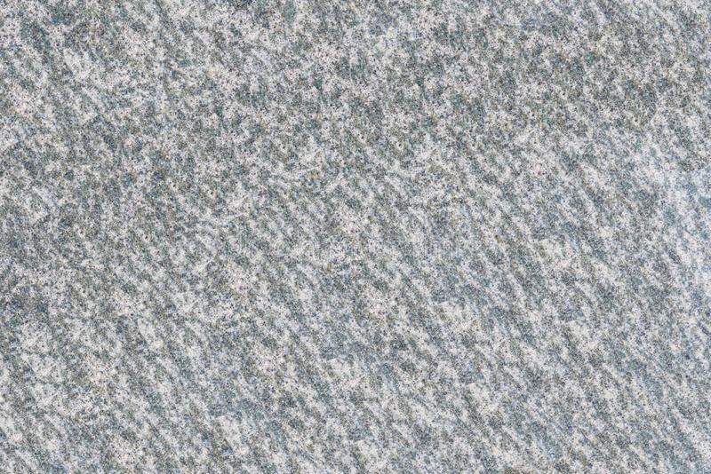 Wall stone texture as background made of real marble, granite. Overhead view, flat lay. stock photography