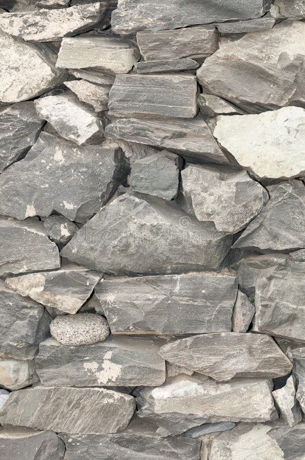Wall with stone textures in grey. Tones stock photo