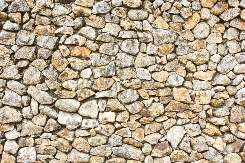 Wall of stones as a texture stock images