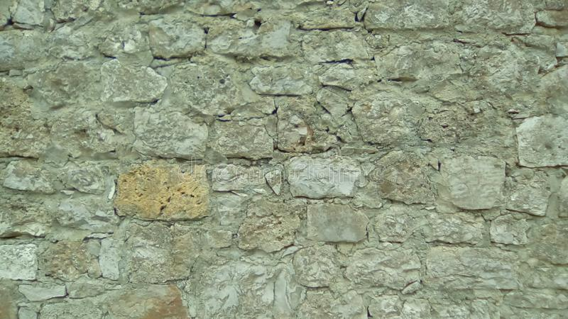 Wall of stones as a texture. stock images
