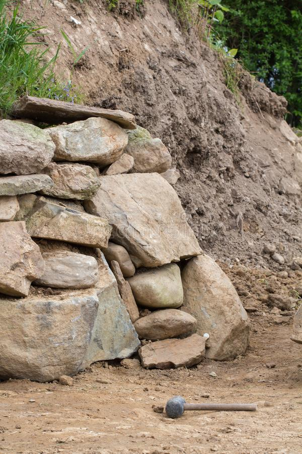 A wall of stones in the garden stock image