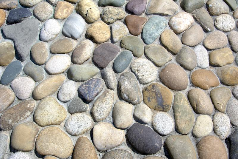Wall of stones in the open. Retro technology royalty free stock image