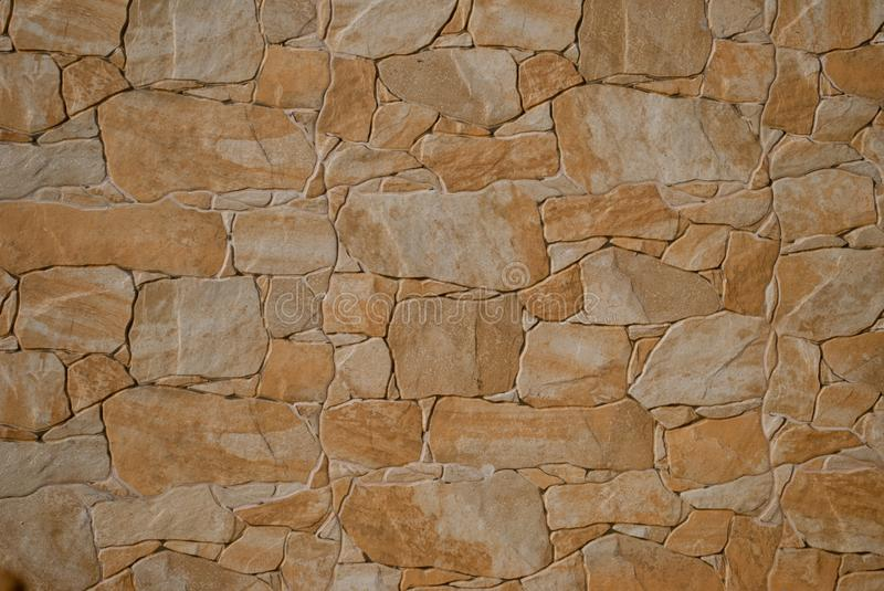 Wall of stones, stone wall, marble, granite texture of gray color on a summer day. Large wall of natural stone marble texture, mosaic, stone fence. natural stone stock photography