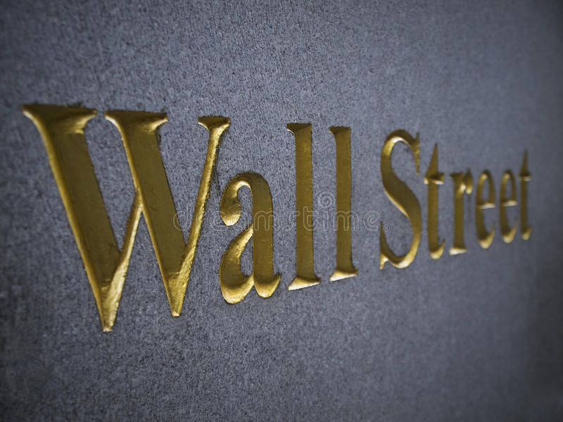 Wall Street. Carved in stone with golden letters stock photography