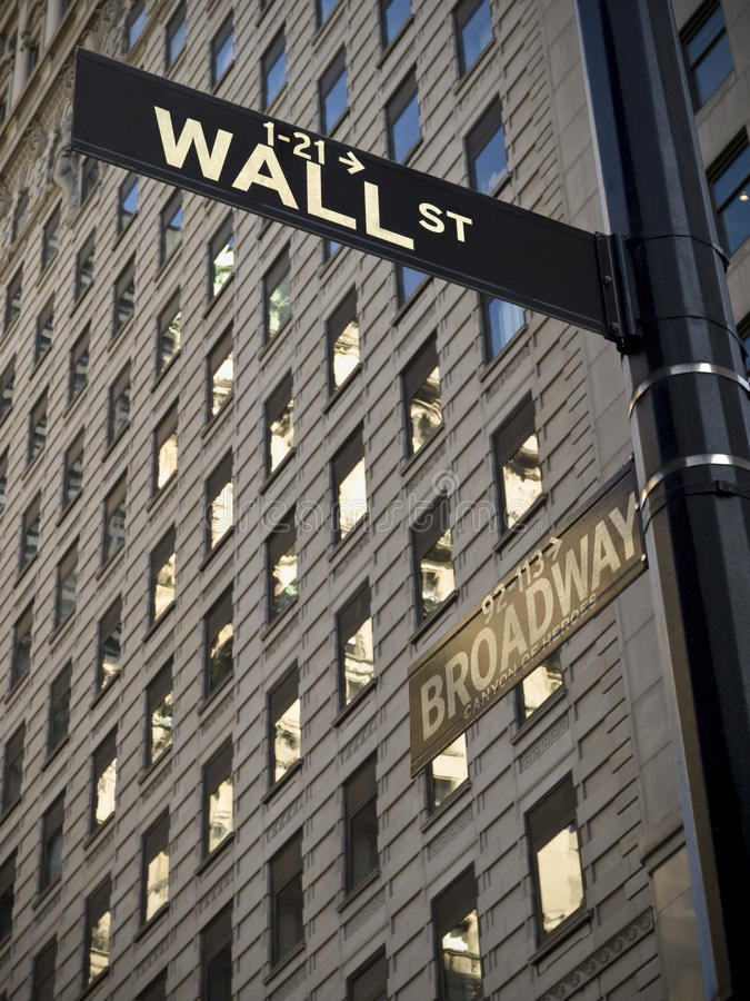 Wall Street. A Wall Street sign when it crossover with Broadway in Manhattan New York royalty free stock image