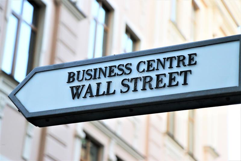 Wall Street direction sign. Business center information road signage. royalty free stock photos