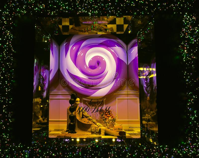 Holiday window display at Saks Fifth Avenue in NYC. New York City - December 21, 2016: Christmas Holiday window display at Saks Fifth Avenue in NYC on December royalty free stock images