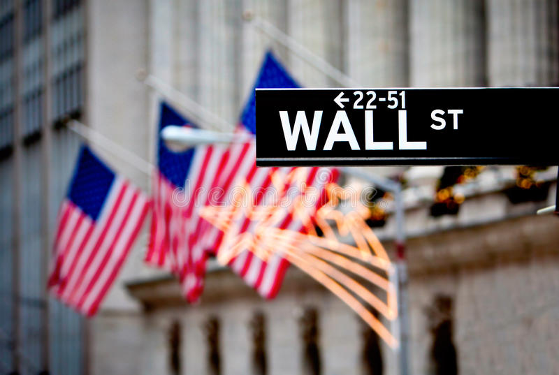 Wall Street sign. In New York with New York Stock Exchange background royalty free stock photo