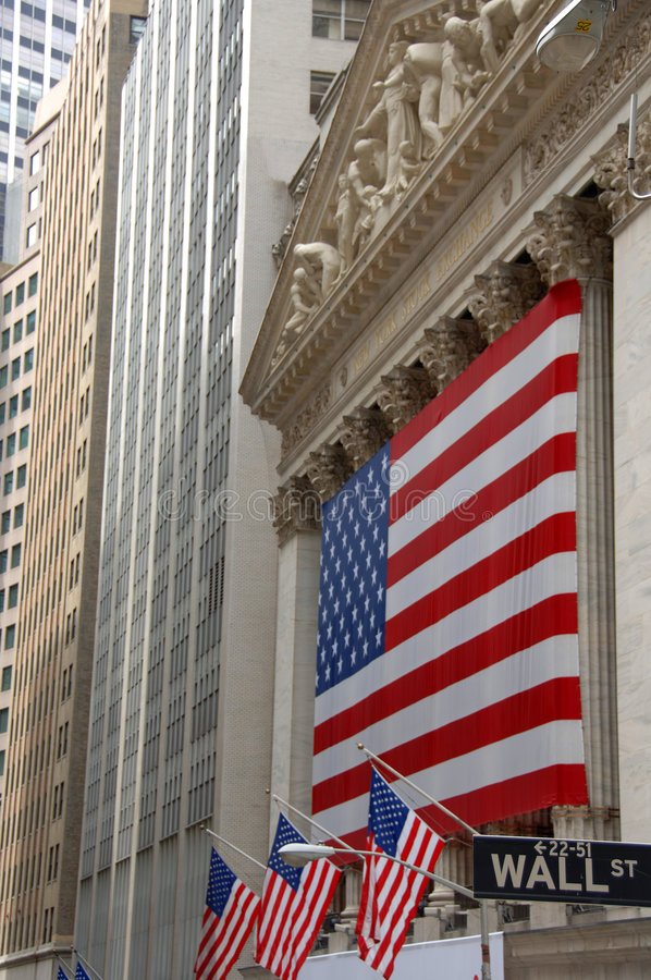 Wall Street, street sign, with US flag stock photos