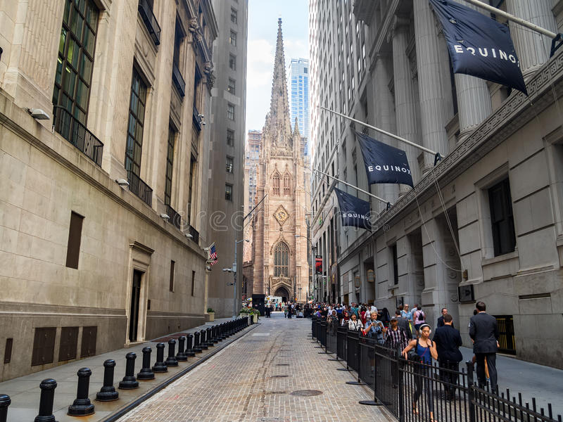 Wall Street and Trinity Church in New York stock photo