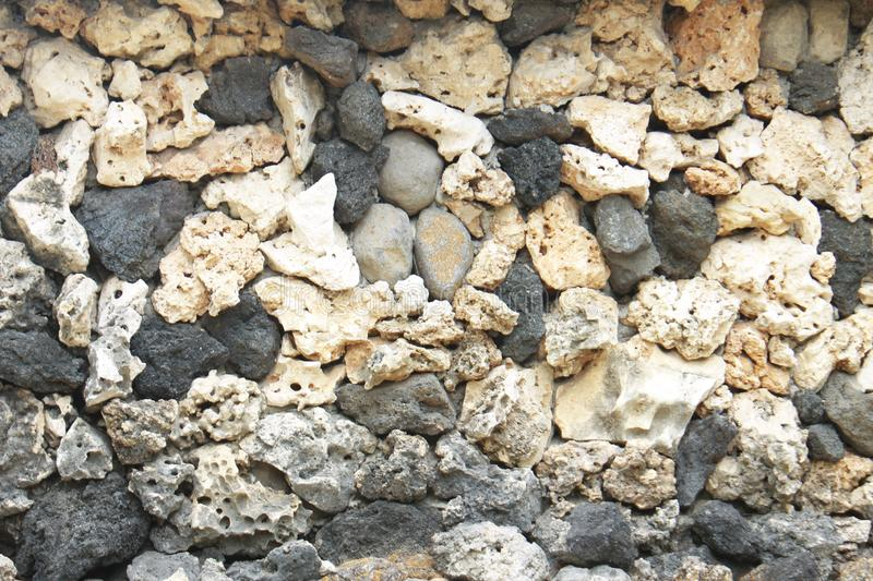 Wall surface with unique stones stock images