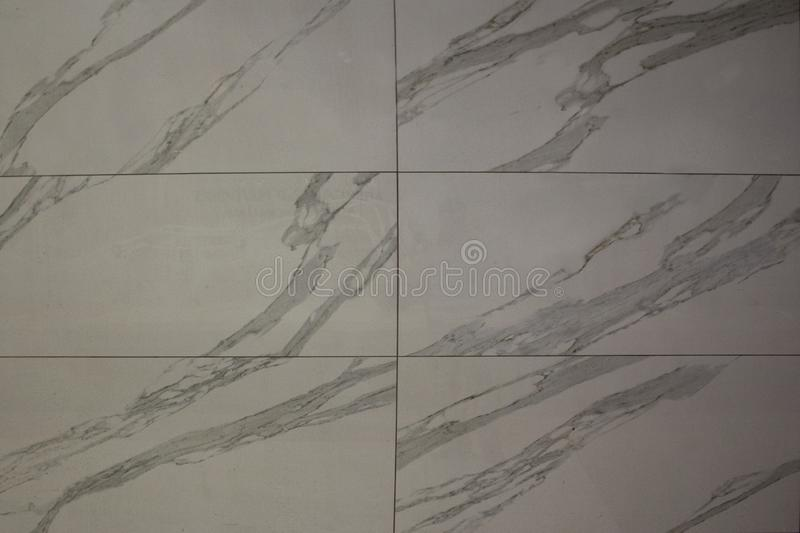 Wall texture with white grey tiles with grey lines. royalty free stock photos