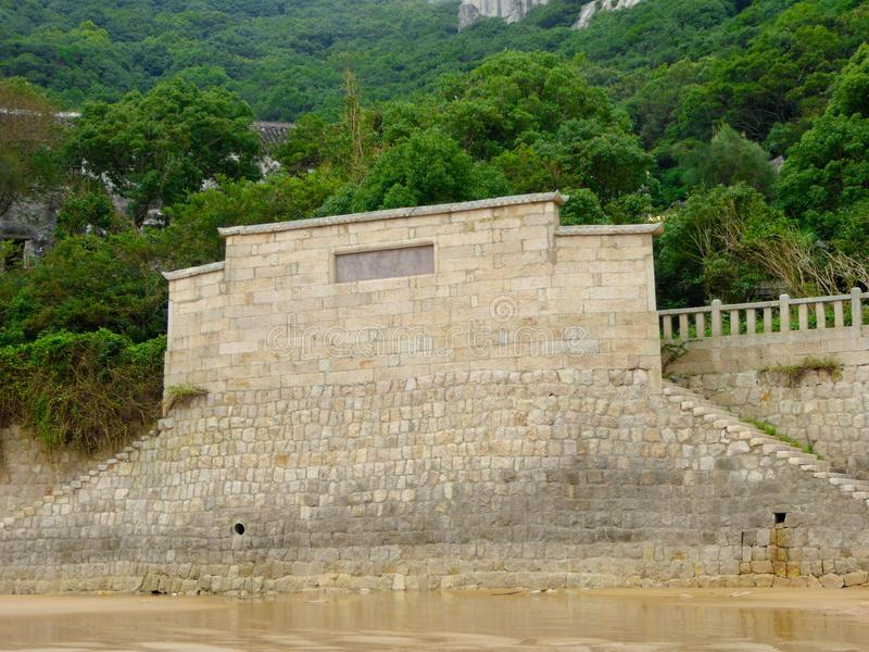 Wall on Thousand step sand beach. A giant stone wall with stairs on Thousand step sand beach in Mount Putuo zhoushan city zhejiang province China royalty free stock images