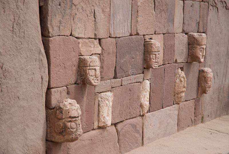 Wall in Tiahuanaco with stone faces royalty free stock photos