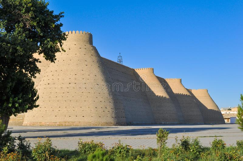 Wall and towers of the ancient citadel in Bukhara `Ark citadel`. Wall and towers of the ancient citadel in Bukhara `Ark citadel`, Uzbekistan royalty free stock photography