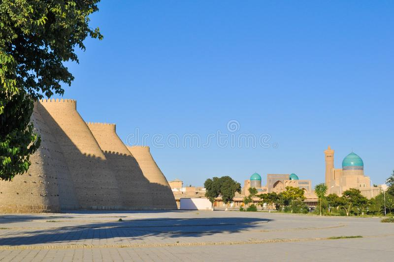 Wall and towers of the ancient citadel in Bukhara `Ark citadel`. Wall and towers of the ancient citadel in Bukhara `Ark citadel`, Uzbekistan royalty free stock images