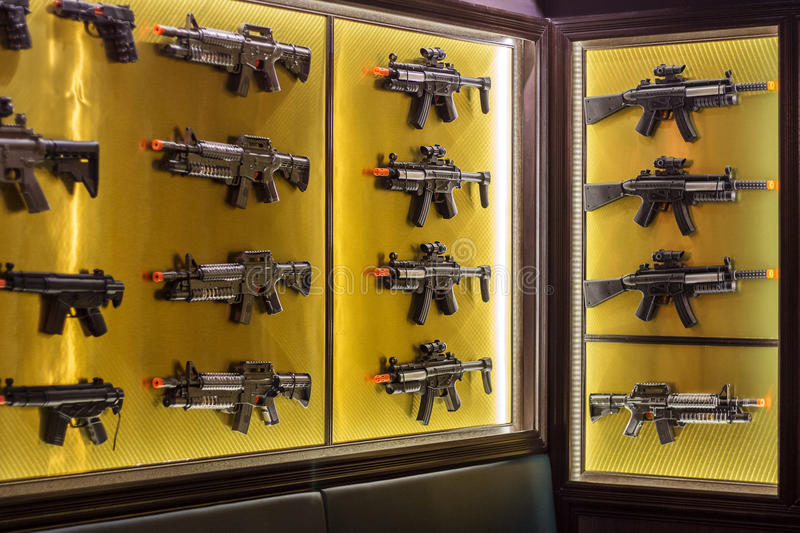 Wall of toy guns. Concept of gun control. Collection of toy machine guns display on a wall instead of real gun stock images