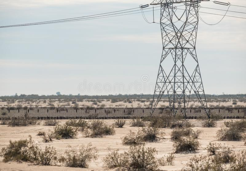 Border wall at the Imperial Valley, southern California. Wall between the USA and Mexico at the Imperial Valley, California royalty free stock photography