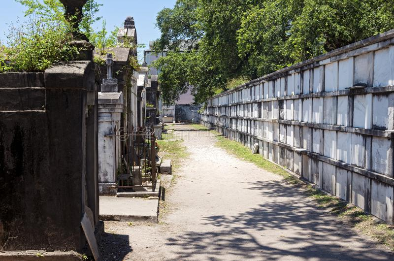 Wall Vaults and Tombs at Historic Cemetery in New Orleans. Wall vaults and tombs for the deceased at historic cemetery in garden district of new orleans stock image