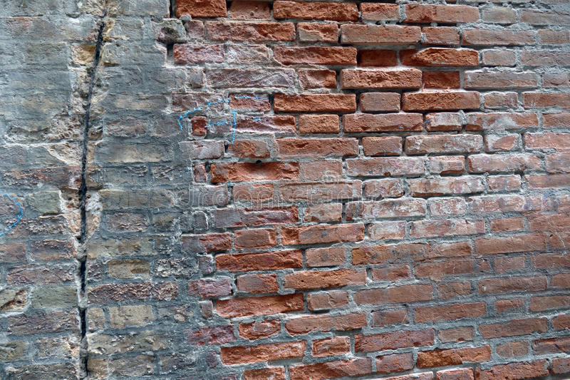 Wall Venice partially destroyed plaster. royalty free stock photo