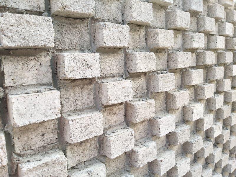 Walking along brick wall royalty free stock photo