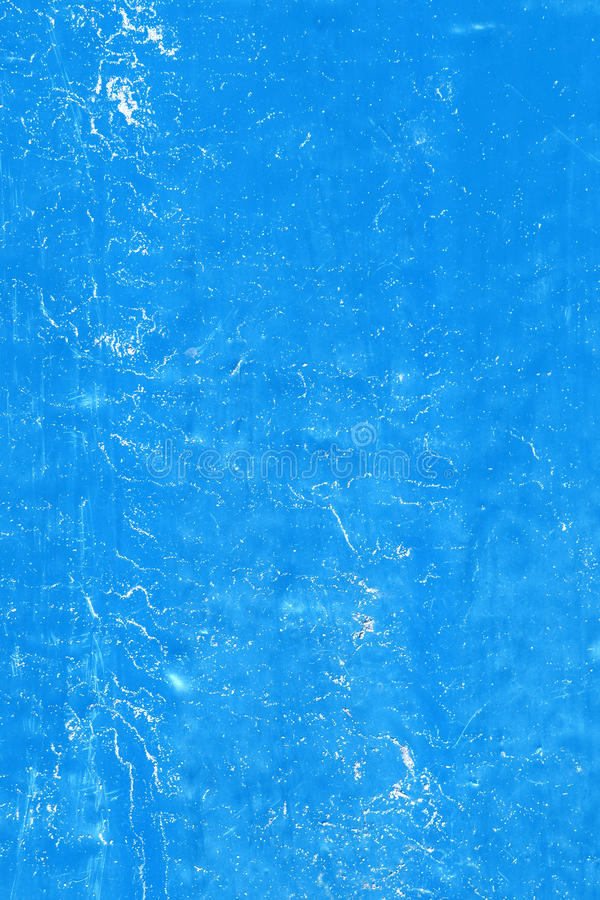 Wall with weathered blue paint pattern background royalty free stock photo