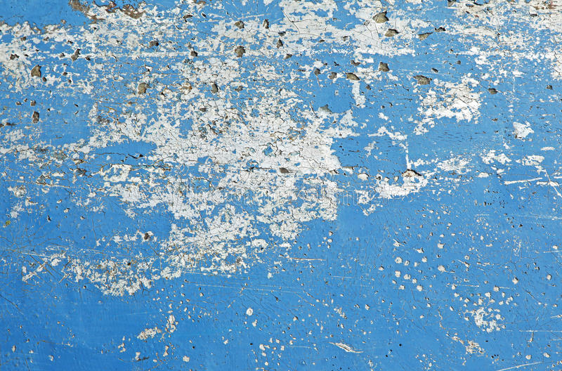 Wall with weathered blue and white peeling paint b stock photos