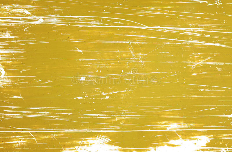 Wall with weathered pattern mustard colored paint royalty free stock photo