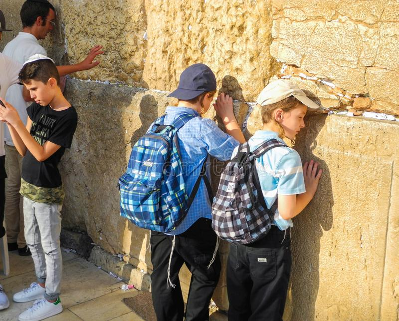 At the wall of weeping. Jerusalem, Israel - August 23, 2016 - Jewish boys praying at the wall of weeping