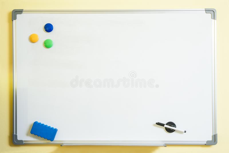 The wall on which a white magnetic board for writing hangs.  royalty free stock photos