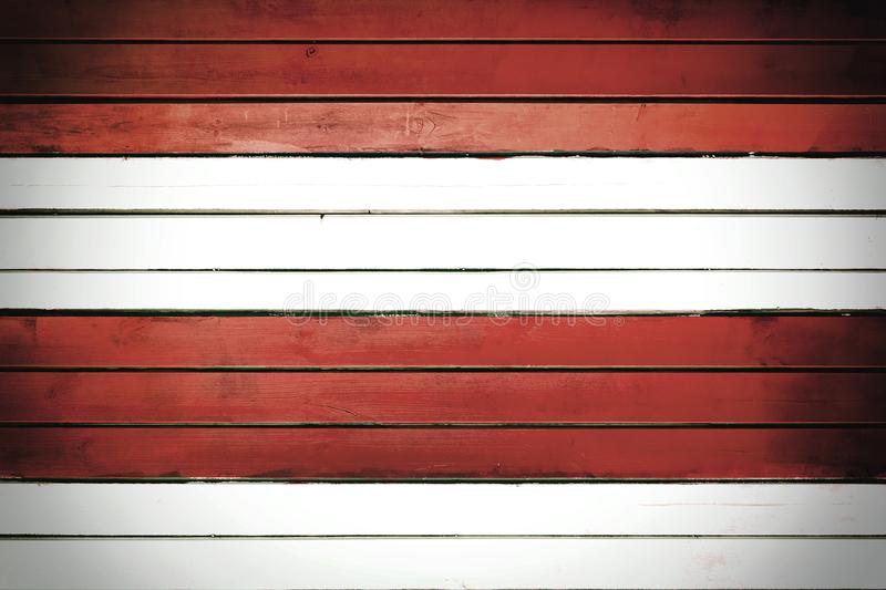 Wall of white and red horizontal slats. Texture of painted thin boards. Blank background with vignette royalty free stock photos