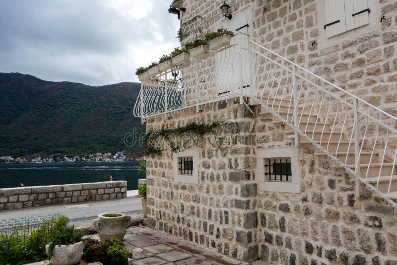 Wall white stone house standing next to the promenade stock photo