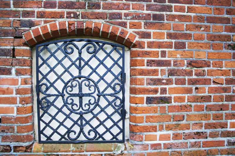The wall with window of broken and abandoned red brick house. royalty free stock photo
