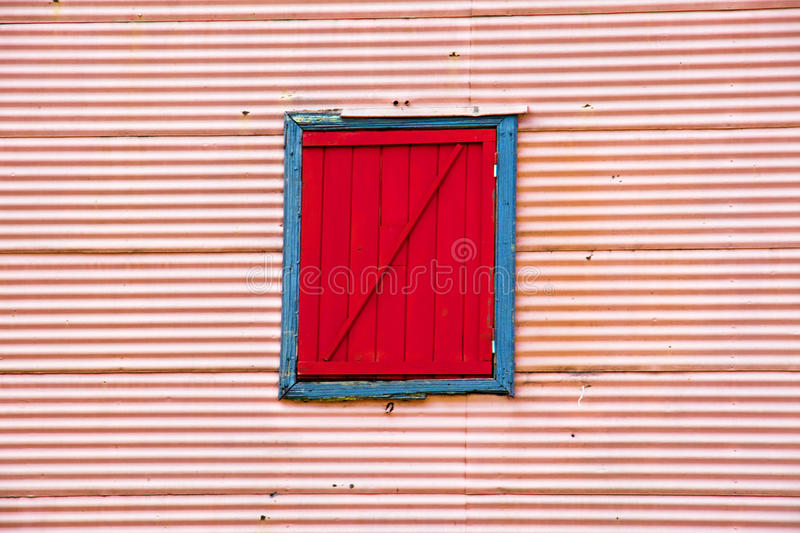 Wall with window in La Boca. Pink wall with red window in La Boca, Buenos Aires royalty free stock photos