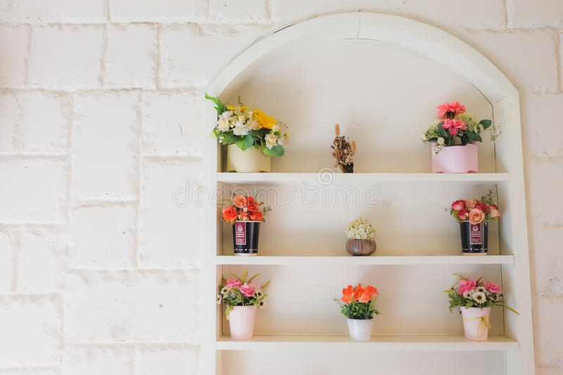 The wall with windows and flower stock photo