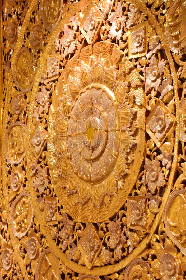 Wall wood carved golden lotus bloom royalty free stock image