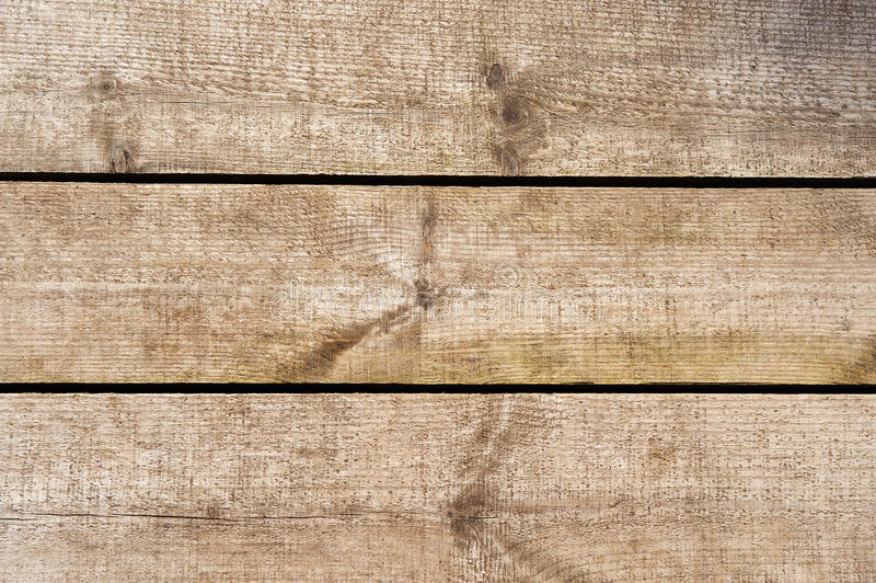 Wall of wooden planks. Wall of rough wooden planks royalty free stock photos