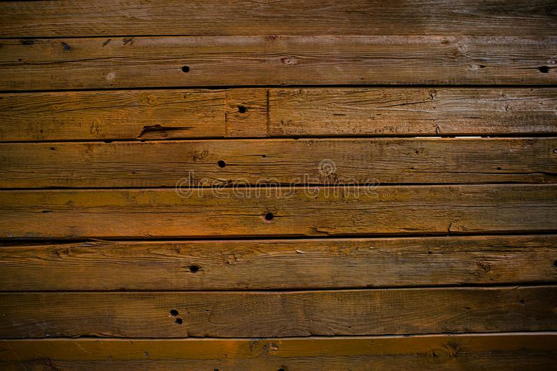 The wall of wooden planks. Wooden background. The texture of the board. Wood texture stock photo