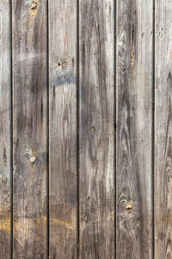 Wall wooden planks painted white grey. The wall of wooden planks painted in white or gey royalty free stock photography