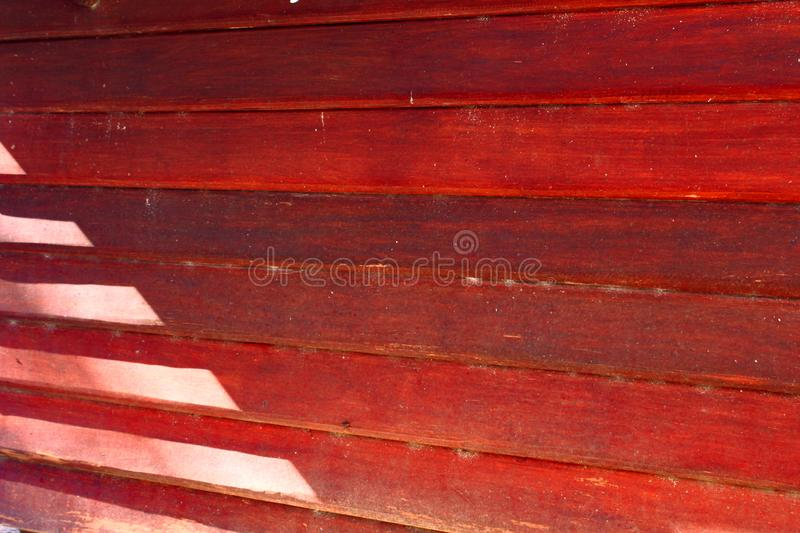 Wall Wooden Surface Golden sun shadows shapes Background. Old Style Design Traditional Natural Home Warm royalty free stock photos