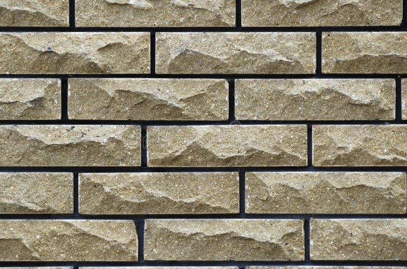 Wall of yellow bricks stock photos