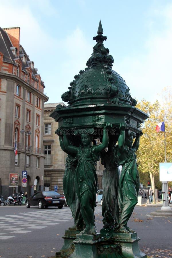 Wallace fountain, Paris. Wallace fountain, Famous Wallace public drinking fountain 1872 in Paris royalty free stock image