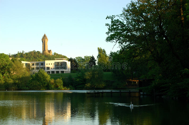 Wallace Monument, Stilring. The William Wallace Monument, seen above Airthrey Loch on the University of Stirling campus royalty free stock photos