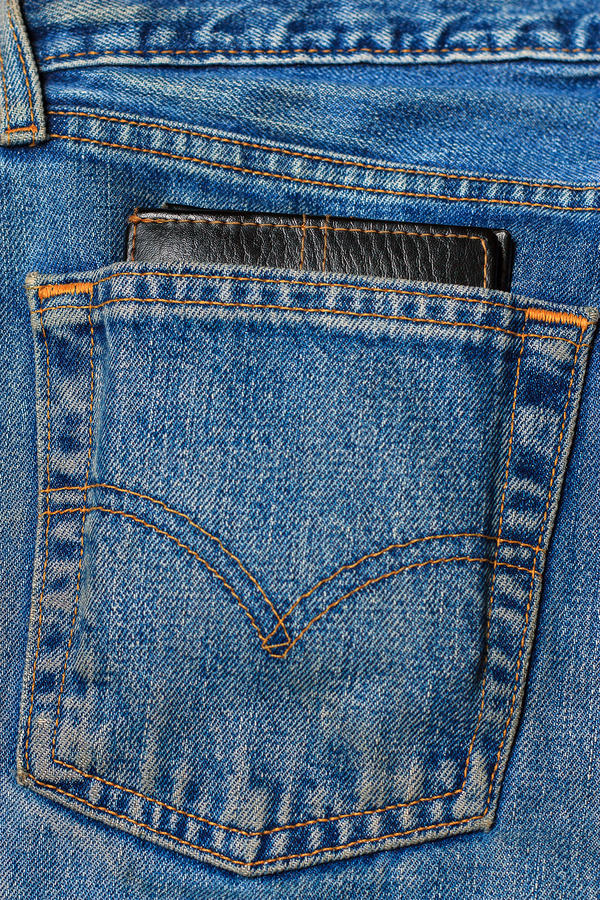 Wallet in the back pocket of jeans stock photography